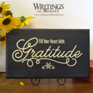 Fill your heart with gratitude. Vinyl wall decal with a pretty script and scrolls. Thanksgiving or any occasion. It's always a good time to be grateful.